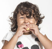 Little girl eating. French bread Stock Photography