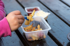 Little girl eating french fries Royalty Free Stock Photo