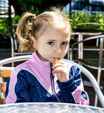 Little girl eating french fries Stock Image