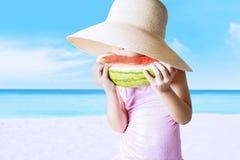 Little girl eating a fresh watermelon Stock Photos