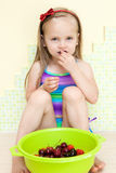 Little girl eating fruit Stock Photo