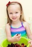 Little girl eating fruit Royalty Free Stock Image