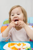 Little Girl Eating Fruit Royalty Free Stock Photography