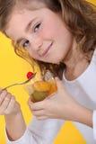 Little girl eating fruit Stock Photo