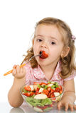 Little girl eating fruit salad Stock Photography