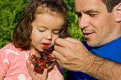 Little girl eating fruits Royalty Free Stock Image