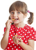 Little girl eating gelatine candy Royalty Free Stock Photo