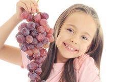 Little girl eating grape Royalty Free Stock Photography