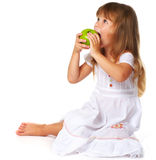 Little girl eating green apple Royalty Free Stock Photo