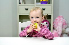 Little girl eating green apple Royalty Free Stock Photography