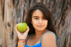 Little girl eating a green apple Stock Photography