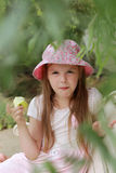Little girl eating green apple Royalty Free Stock Images