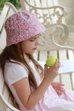 Little girl eating green apple Royalty Free Stock Image