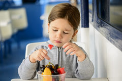 Little girl eating healthy snack Royalty Free Stock Image