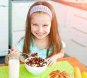 Little girl eating her breakfast Stock Photo