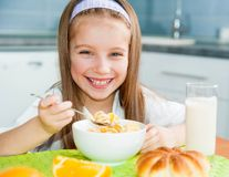 Little girl eating her breakfast Stock Image