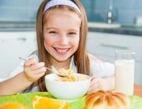Little girl eating her breakfast Stock Image