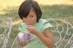Little girl eating ice cream Stock Image