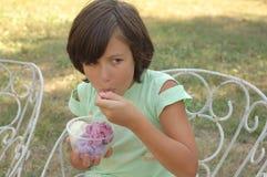Little girl eating ice cream Stock Image