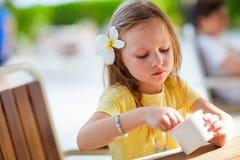 Little girl eating ice cream Royalty Free Stock Photo