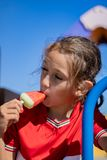 Little girl eating an ice cream royalty free stock photography