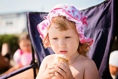 Little girl eating ice cream on beach vacation Stock Photo