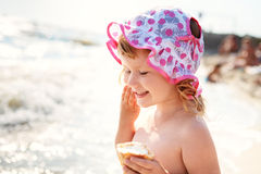 Little girl eating ice cream on beach vacation Royalty Free Stock Images