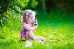 Little girl eating ice cream Stock Photos