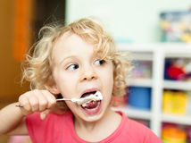 Little girl eating ice-cream Royalty Free Stock Images