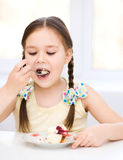 Little girl is eating ice-cream Royalty Free Stock Images