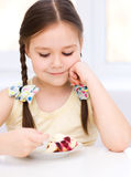 Little girl is eating ice-cream Royalty Free Stock Image