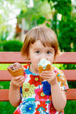 Little girl eating ice cream Stock Photo