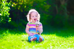 Free Little Girl Eating Ice Cream In The Garden Royalty Free Stock Image - 55566836