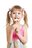 Little girl eating ice cream isolated Stock Photography