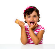 Little girl eating ice cream. Isolated on white Stock Photography