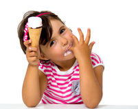 Little girl eating ice cream. Isolated on white Royalty Free Stock Images