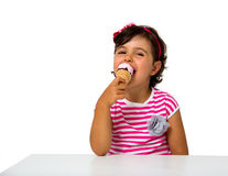 Little girl eating ice cream Royalty Free Stock Photo