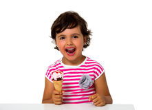 Little girl eating ice cream Stock Images