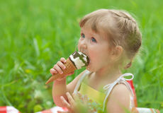 Little girl eating ice cream outdoor Stock Photography