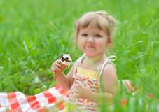 Little girl eating ice cream outdoor Stock Images