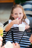 Little girl eating ice cream Royalty Free Stock Photography