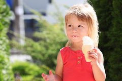Little girl eating ice cream outdoors Stock Photo