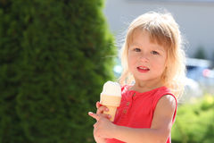 Free Little Girl Eating Ice Cream Outdoors Stock Photography - 34374202