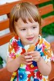 Little girl eating ice cream outside Royalty Free Stock Image