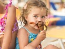 Little Girl Eating Ice Cream Stock Photography