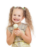 Little girl eating ice cream in studio isolated Royalty Free Stock Photography