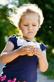 Little girl eating an ice-cream Stock Photos