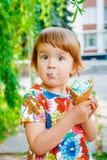 Little girl eating ice cream Royalty Free Stock Photos