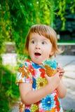 Little girl eating ice cream Royalty Free Stock Image