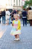 Little girl eating ice cream walking in the city Royalty Free Stock Photography